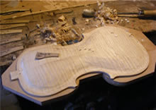 Initial carving of violin back